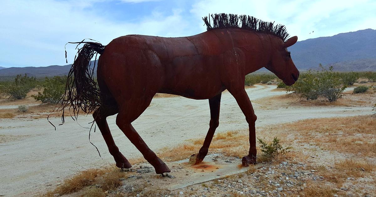 running horse metal art sculpture